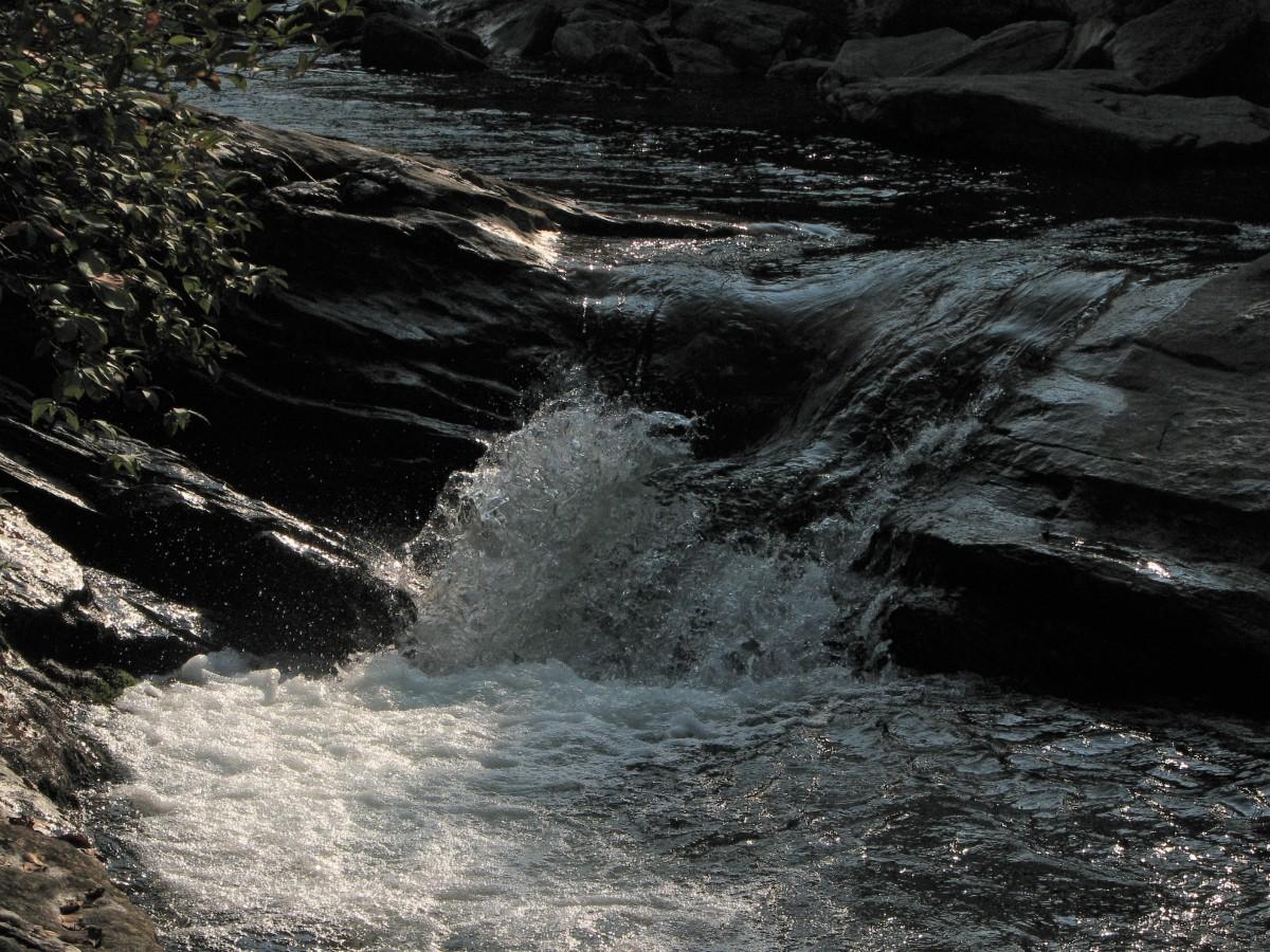 Water splashing over rocks in stream.