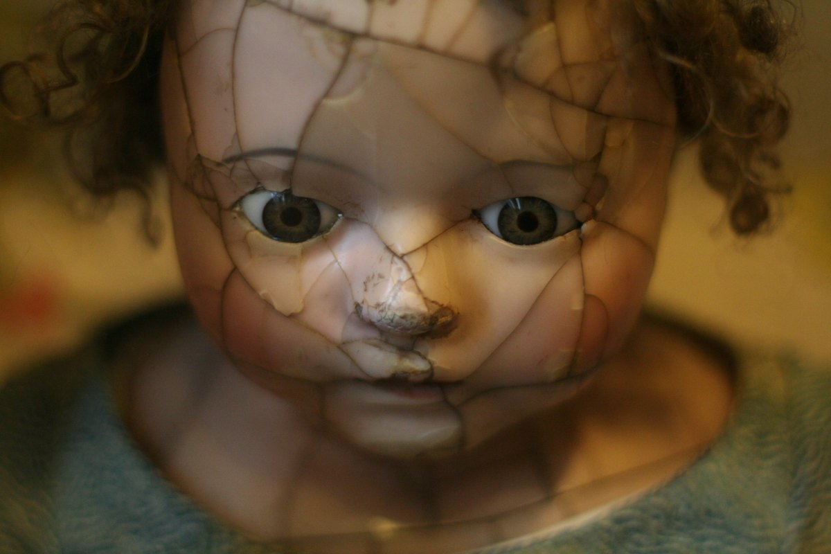 porcelain doll with cracked face