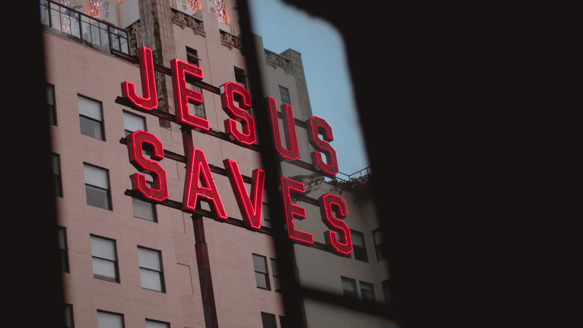 "Neon sign on building ""Jesus Saves"""