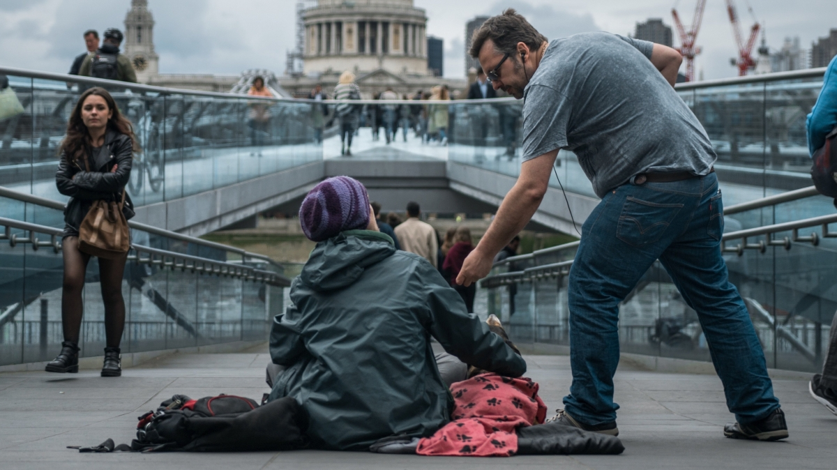Man helping homeless person