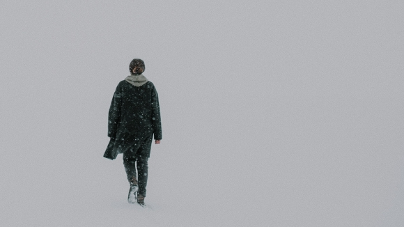 lone person in totallyl white, snowy emptiness